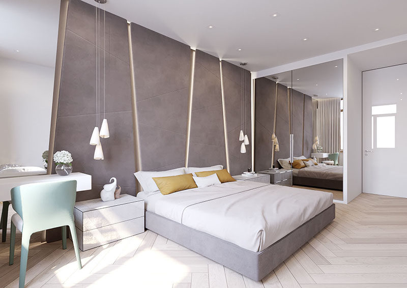 The angular upholstered headboard in this modern bedroom