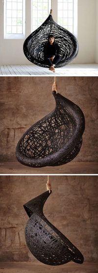 This unique hanging chair design is made from black ...
