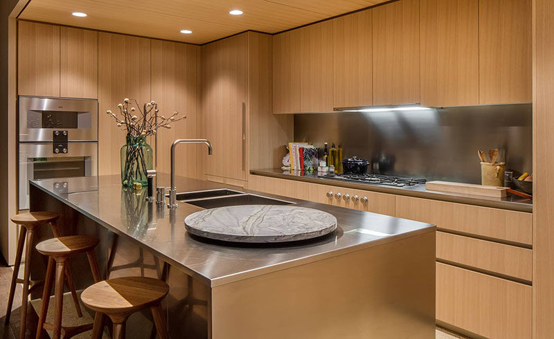 kitchen wood cabinets aldo cabinet oak and satin finish stainless steel make up this modern features honey hued american with
