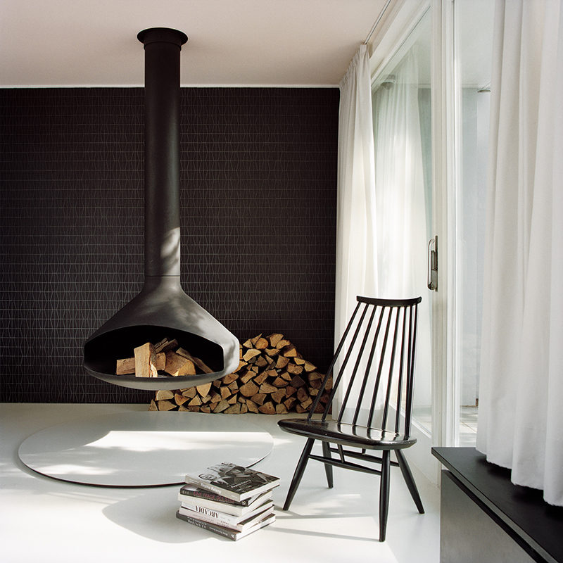 a hanging fireplace and black accent