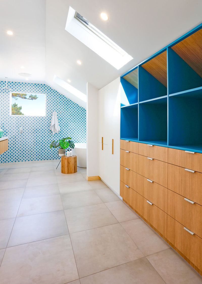 This White And Wood Bathroom Has A Bright Blue Accent Wall