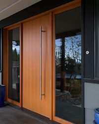 These 13 Sophisticated Modern Wood Door Designs Add A Warm ...