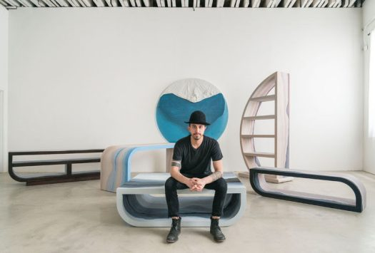 Designer Fernando Mastrangelo has created the Escape Collection, a group of modern furniture pieces that are made using hand-dyed sand and silica to create simple forms that look like a three-dimensional landscape painting.