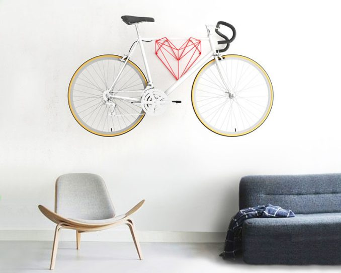 Hang Bike have created Heart, a new minimalist wall-mounted bike rack design in the shape of a heart, that that looks just as good by itself as well as when it's storing a bike.