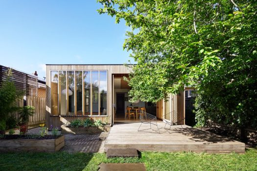 This contemporary wood extension with back deck was added to a turn-of-the-century house in Australia.