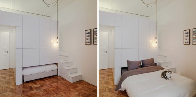This small modern apartment has a wall of white storage cabinets that allows a pull-out bed to be hidden within it. Depending on how much you pull the bed out, it can also double as a couch or day bed.