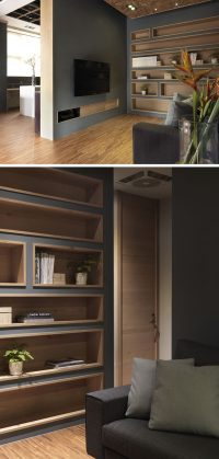 Built-In Bookshelves Lined With Wood Highlight The ...