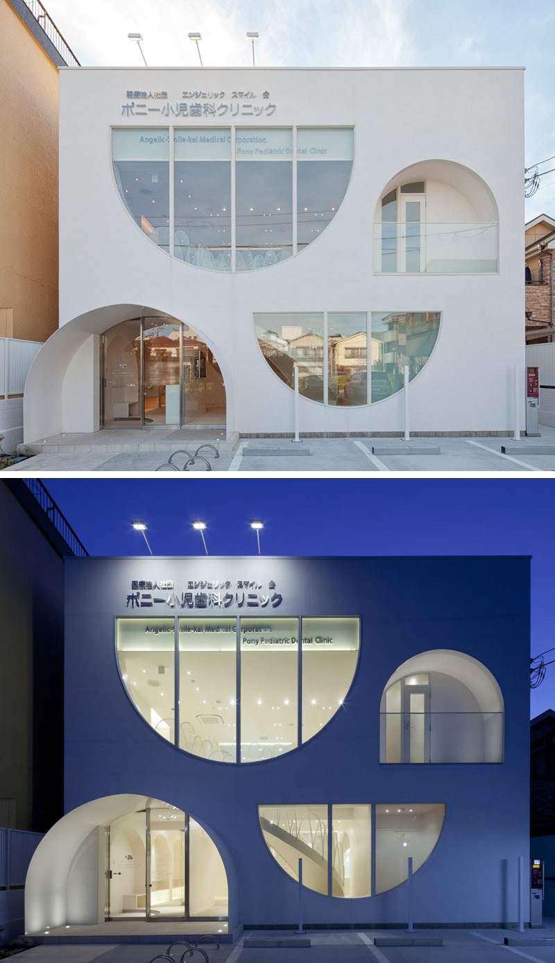 The windows of this white dental office building are playful, with the curved shapes continuing on through to the inside of the clinic.