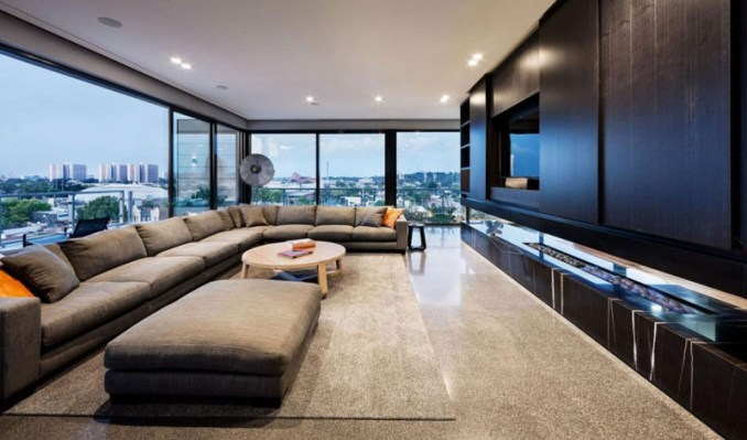 This modern penthouse is decorated in hues of blacks and greys, and has plenty of space for entertaining.