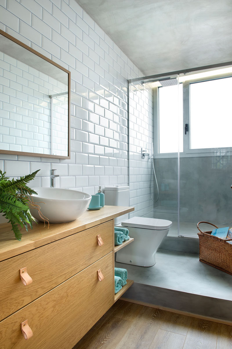 Concrete Wood Tiles And Black Accents Are All Combined