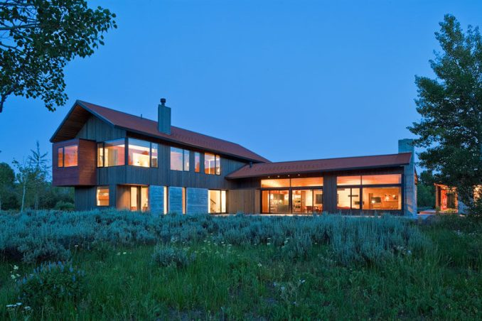 Dynia Architects have designed this contemporary mountain home that sits at the base of the Teton Mountains in Wyoming.