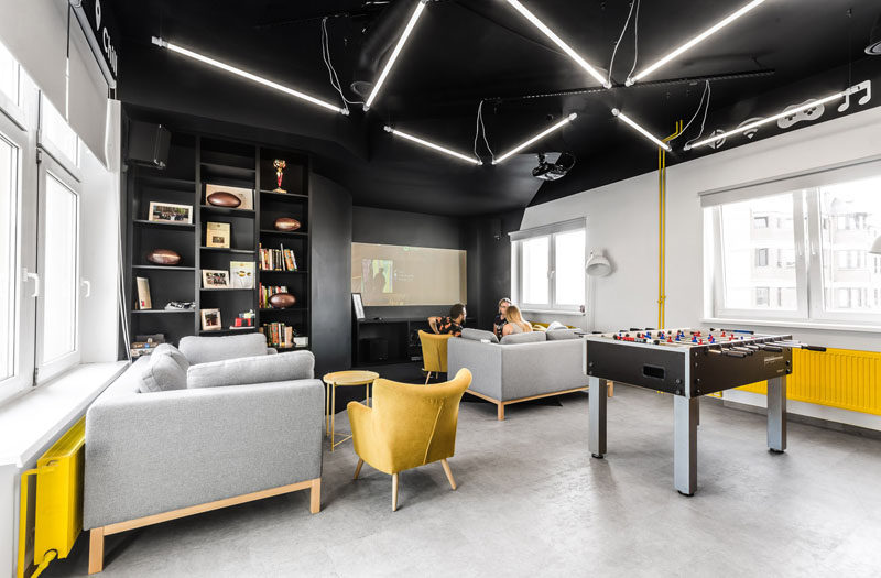 This New Office Interior Uses Wood And Black Frames To