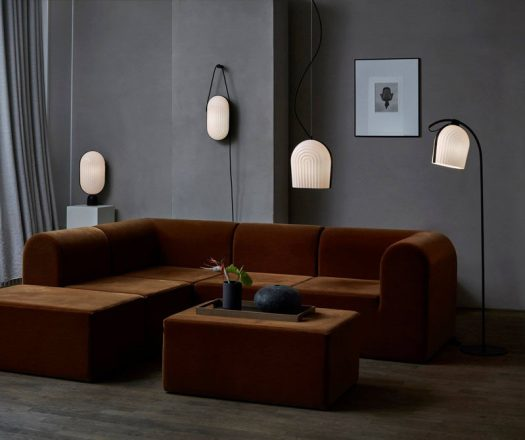 Manér Studio have designed the ARC lighting collection that was inspired by architecture and made with white pleated shades and black colored oak elements. #Lighting #Design
