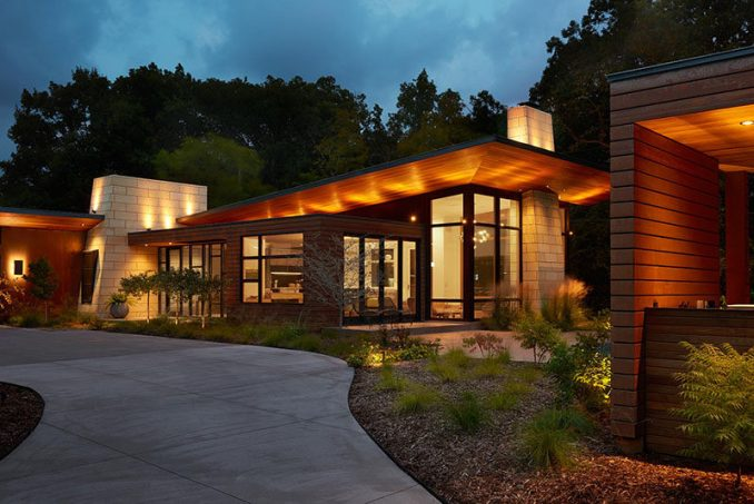 This modern ranch house uses a variety of key materials throughout its design, like Corten Steel wall panels, natural Cedar, ground and polished concrete and Kasota limestone. #ModernRanchHouse #ModernArchitecture #HouseDesign