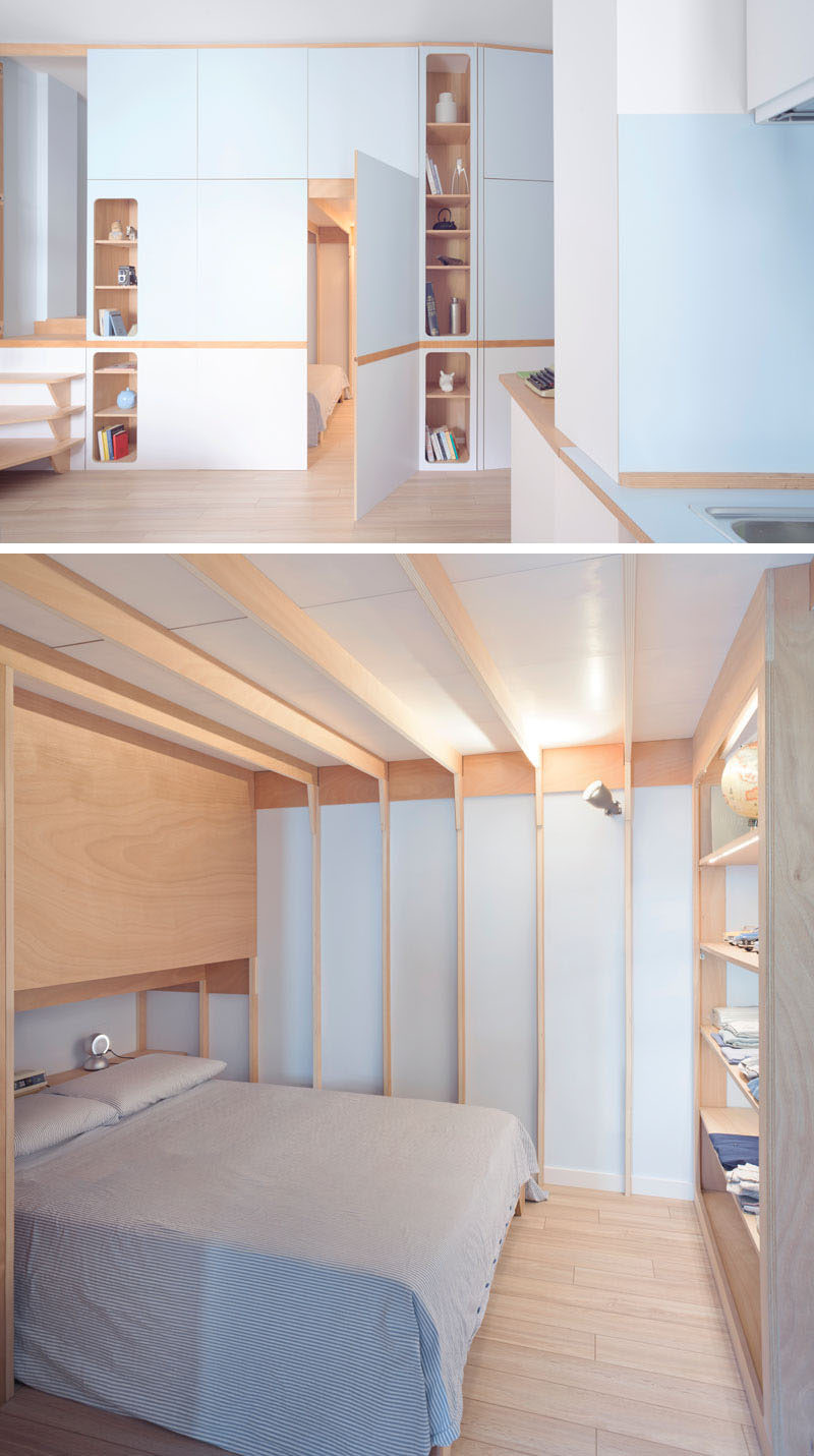 small storage unit for living room english country rooms photos a custom wall in this apartment makes it ...