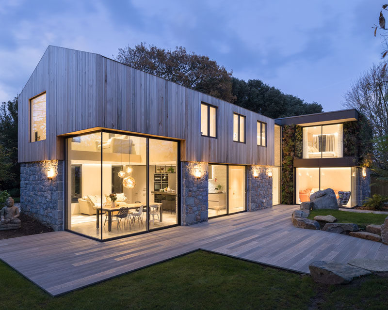 DLM Architects have recently completed a new modern family house on the island of Guernsey, that replaces a run down lot surrounded by trees. #ModernHouse #ModernArchitecture