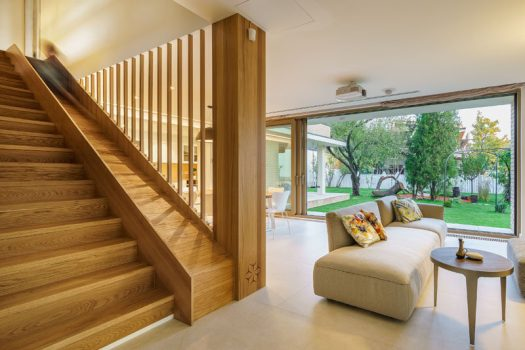 This modern house has wood stairs with a built-in slide for the kids in the family. #WoodStairs #ModernStairs #Slide