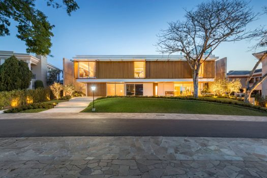This modern Brazilian house has wood shutters on the upper level of the home that blend in with the facade when they're closed. #Shutters #ModernHouse #Architecture
