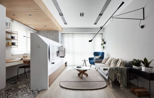 This modern apartment has a pony wall in the living room, that divides the open room and allows the living room to have a display area for the television and storage unit, and a small home office. #HomeOffice #PonyWall #LivingRoom