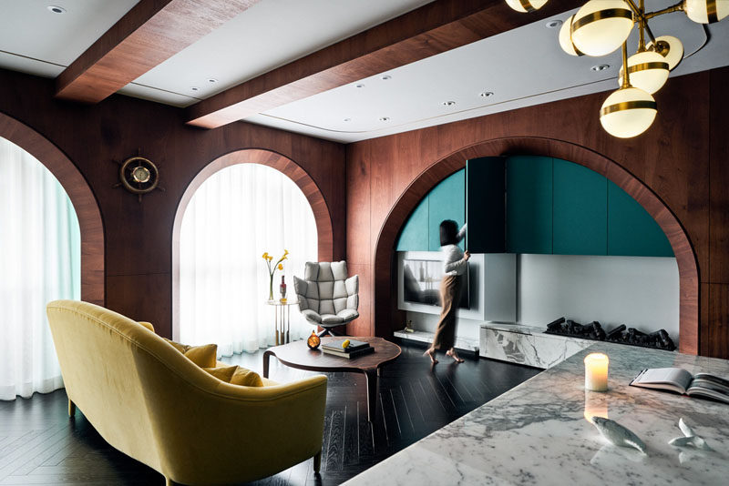 Wood Arches And Turquoise Accents Are Featured Throughout