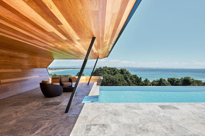 Harley Graham Architects have designed a modern pool cabana, that's clad in wood (Blackbutt), and takes the shape of a wave. #PoolCabana #ModernCabana #SwimmingPool