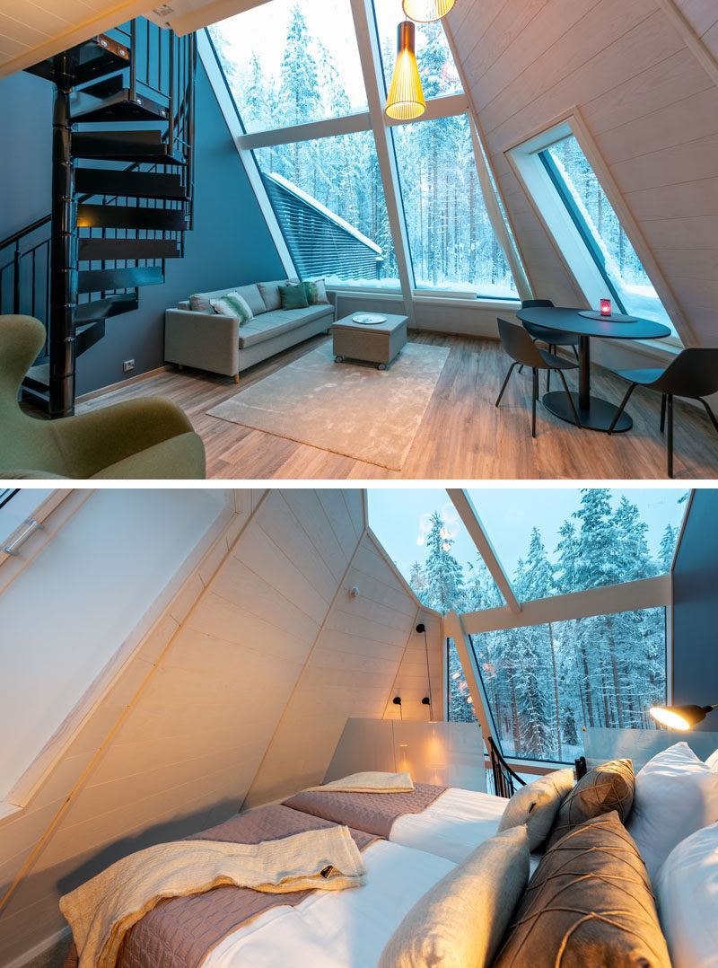Inside this modern cabin, a wall of windows shows off surrounding area, while inside, there's an open plan living room and dining area. A black spiral staircase leads up to the lofted bedroom, which also has a glass ceiling above the bed, making it easy to stargaze at night. #Cabin #Windows #GlassCeiling