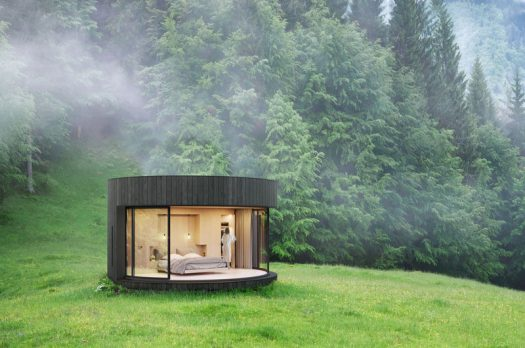 LUMICENE has recently launched LUMIPOD, a small and modern prefab cabin that's designed around their curved window, allowing the interior of the cabin to be opened to nature. #Cabin #PrefabCabin #Design