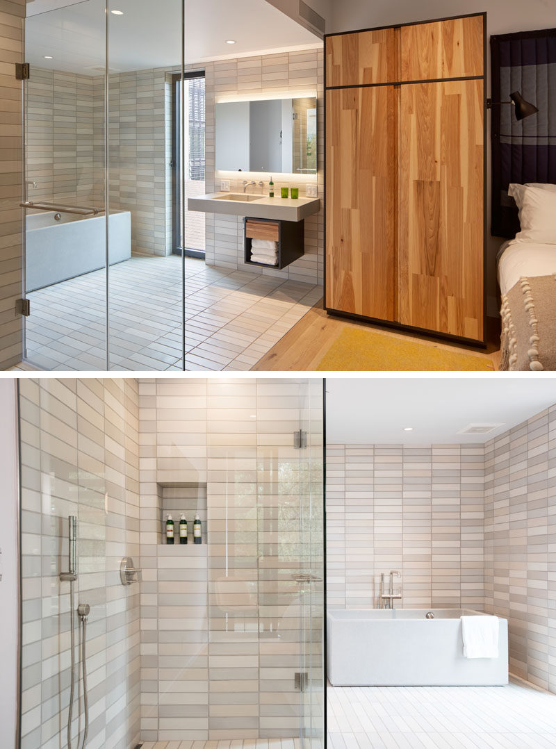 This modern hotel room has an open ensuite bathroom, with both a glass-enclosed walk-in shower, and a Sonoma Stoneworks cast tub and vanity. #ModernBathroom #BathroomDesign #HotelBathroom