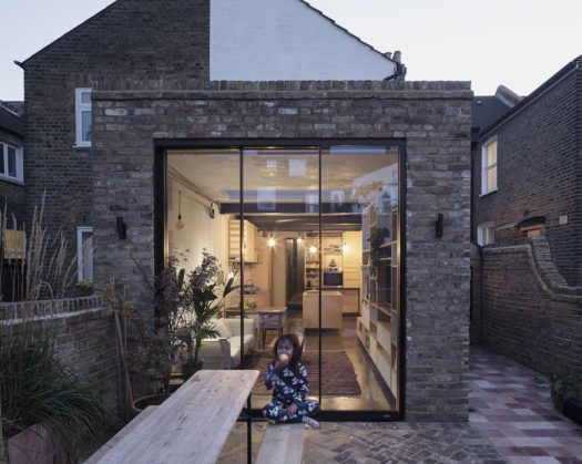 RISE Design Studio has designed the contemporary renovation and extension of a London flat, that's home to a family of five. #BrickExtension #Architecture