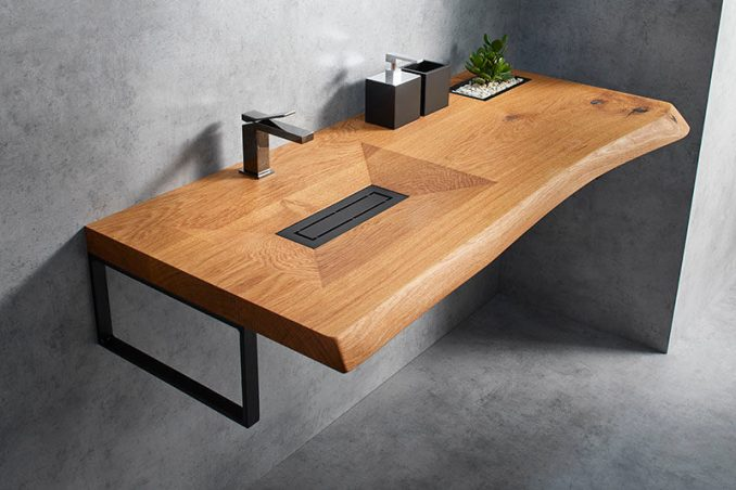 Cone Invi is a modern yet natural bathroom vanity that's made from a single piece of solid wood, with a basin machine-carved out of its surface. #WoodVanity #ModernBathroom #ModernVanity