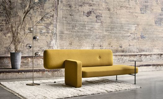 Spanish architect Santiago Bautista, has recently created Pebble, a modern couch with a built-in side table and an asymmetrical design. #ModernCouch #ModernFurniture #Seating