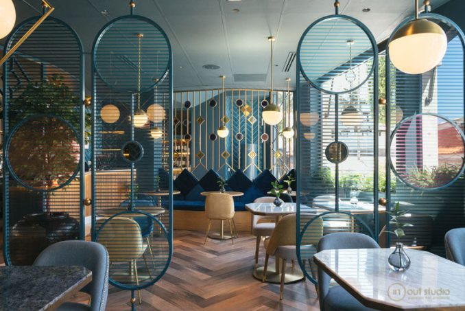 This modern restaurant design includes two room dividers styles to separate the various seating areas. #RoomDivider #Screen #RestaurantDesign