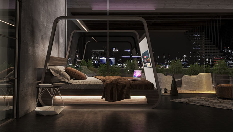 The modern four-poster bed, which has its own app, can be connected to multiple devices to allow the user to operate the 4k projector, the 70-inch screen, as well as the invisible speakers that are built into the frame. #ModernBed #SmartBed #BedWithTV #Furniture #ModernFurniture
