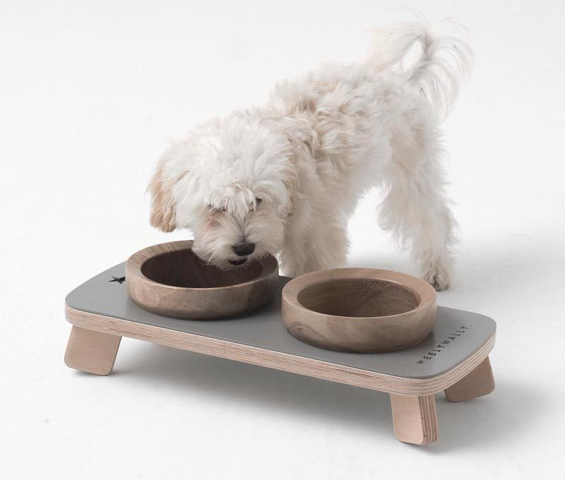 This modern pet food and water bowl stand, has walnut bowls that rest within a platform. #PetFurniture #ModernPetFurniture