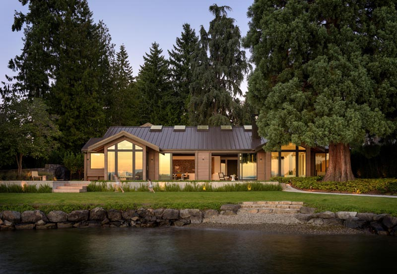 """Architecture firm Olson Kundig, has designed the remodel of a dated """"log cabin"""" inspired ranch house, and created an open, flexible and view-oriented home for an active young family. #ModernHouse #ModernRanchHouse #Architecture #LakeHouse"""