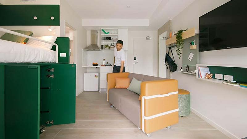 Designed for Sydney co-living space UKO, the small 204 square foot (18sqm) apartment has been designed in a way that lets the occupants customize their space when needed, and a big part of that, is the platform bed that hides a wardrobe, a dining table, and a couch. #PlatformBed #HiddenStorage #SmallLiving #SmallApartment #UnderBedStorage