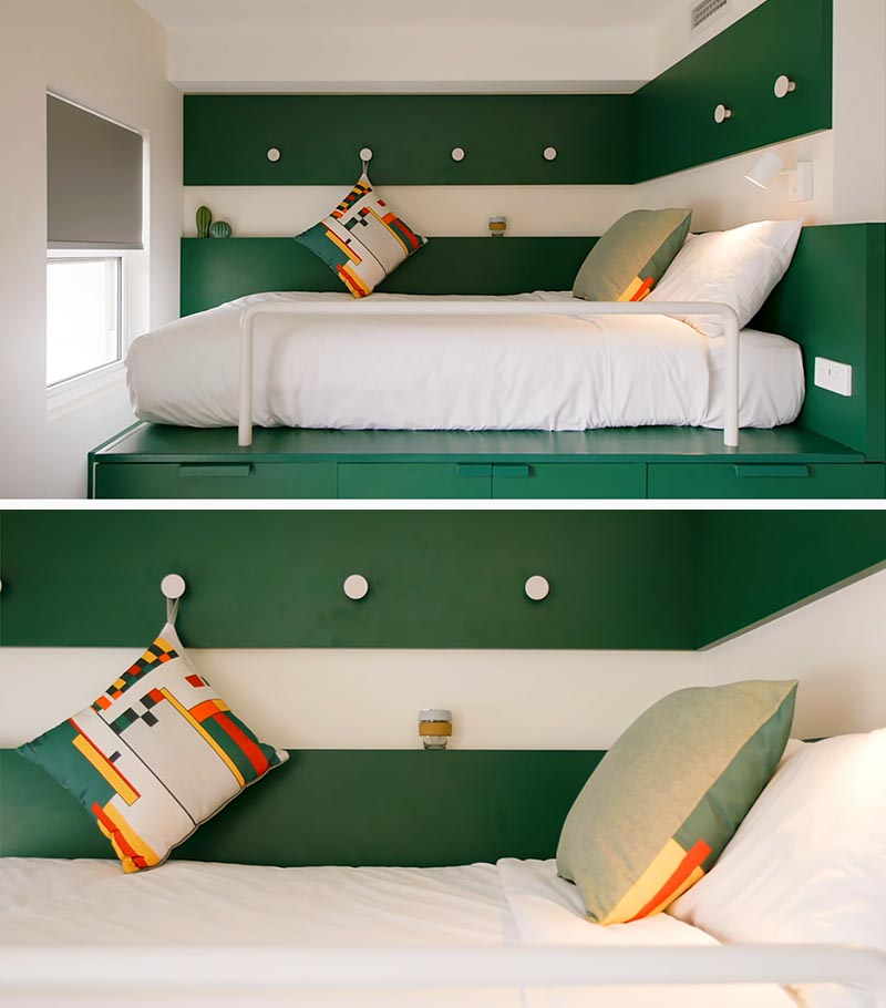 The wrap around paneling in the sleeping area of this platform bed helps to create a bedroom-like feeling, and acts as a small shelf, as well as creates a place to have some hooks, for hanging various items. #PlatformBed #SmallLiving #Bedroom