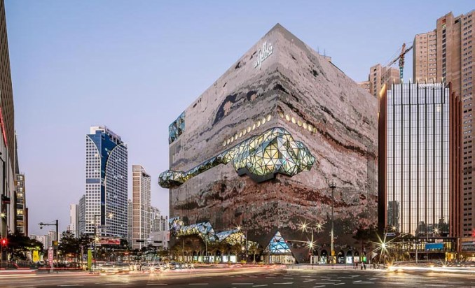 The Galleria department store has a textured mosaic stone facade with multifaceted glass accents that were inspired by the nature of the neighboring park. #DepartmentStore #Architecture #Windows #Facade #BuildingFacade