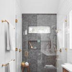 Gold Hardware Is The Accent In This Bathroom S Palette That Also Includes White And Grey Tiles And Wood Drawers