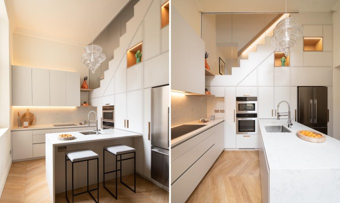 A modern white kitchen with white countertops, LED lighting, and plenty of storage.