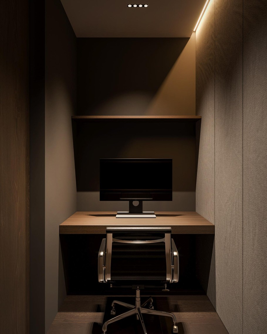 A small home office with a built-in desk is hidden behind a wall in the living room.