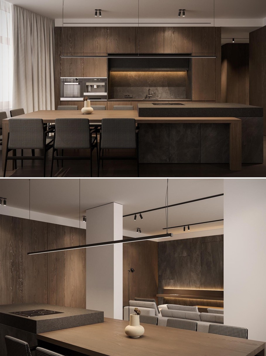 A spacious wood kitchen with black accents has a large island with an extension for seating 8 people.