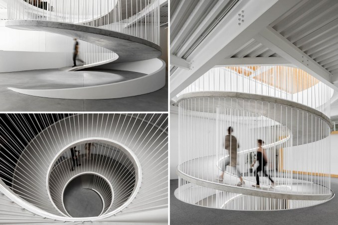 A spiraling ramp replaces the need for stairs in this modern office and adds a sculptural element.