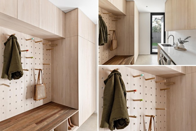 A modern mudroom / laundry room with minimalist wood cabinets, a wood bench, shoe storage, white countertop, and pegboard storage wall.