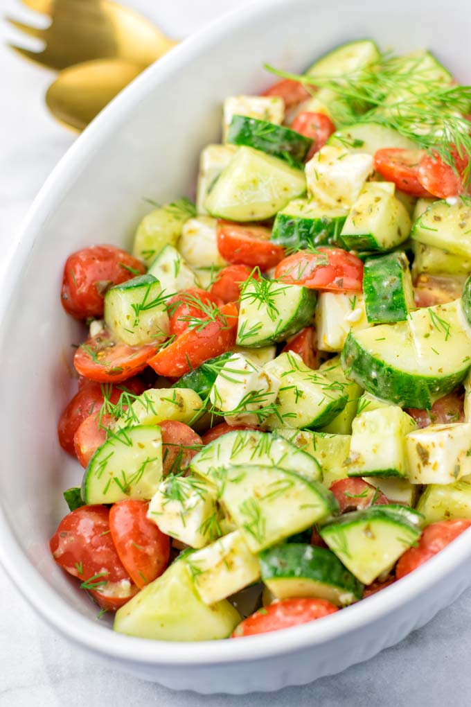 Chop your favorite tomatoes and ca cucumber in not too small pieces.