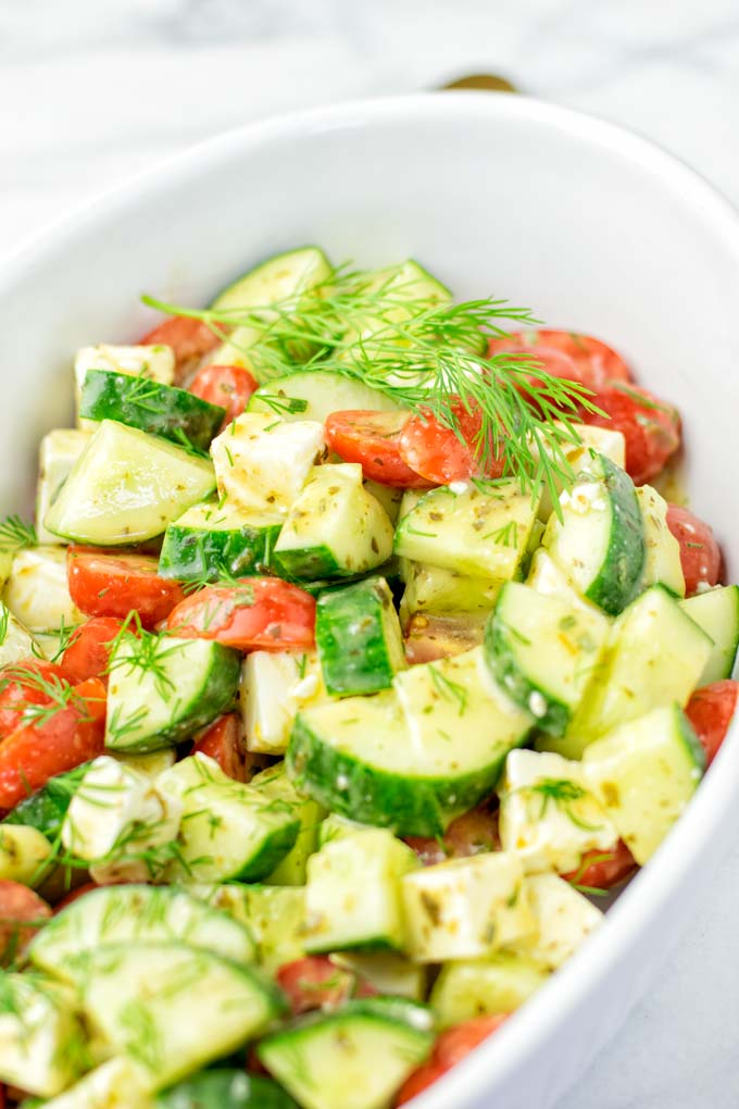 Cucumber and Tomato Salad served in a white bowl.