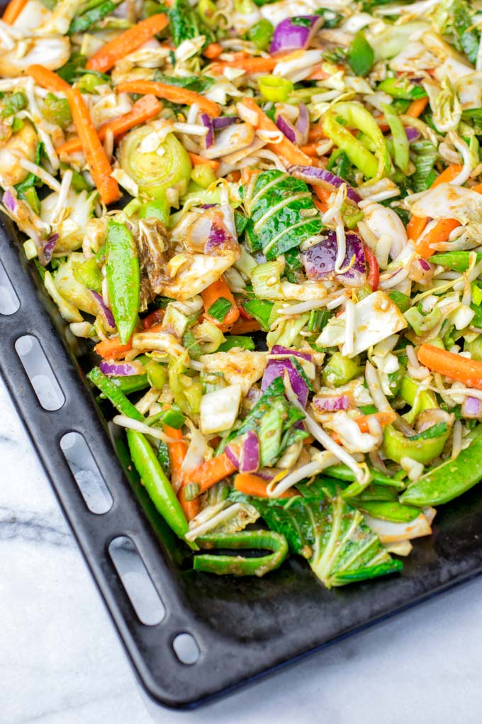 Fresh Thai vegetables on a single sheet pan, ready to go into the oven.