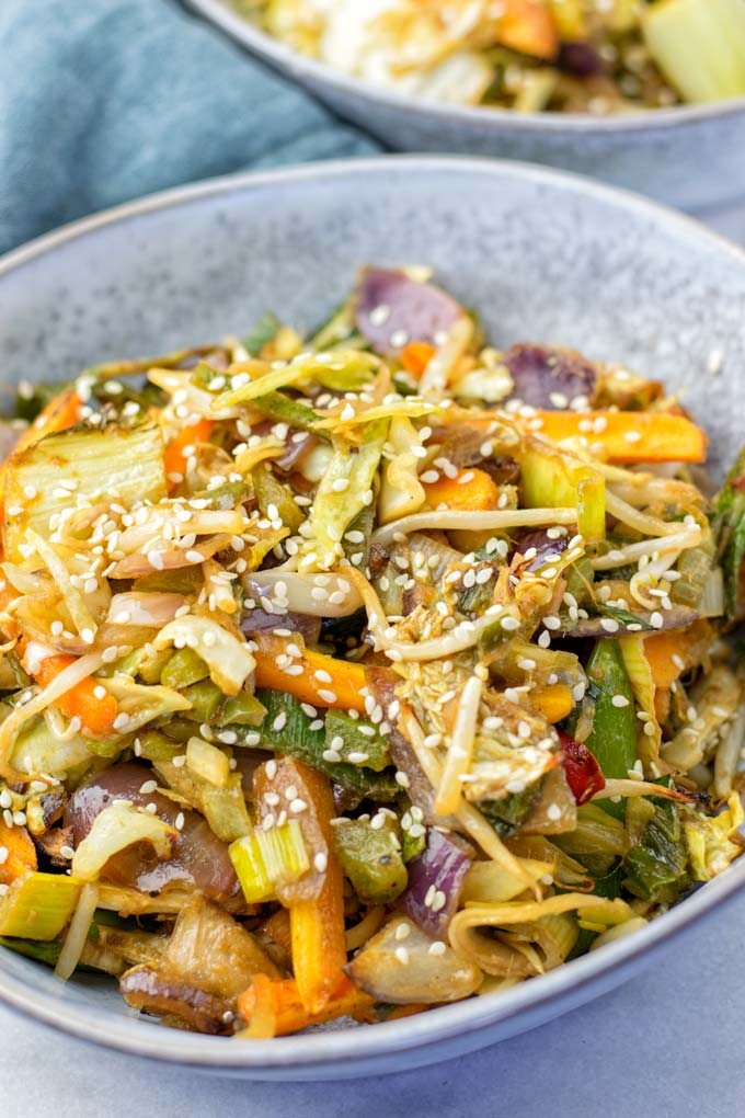 A bowl with the Sheet Pan Thai Vegetables, garnished with sesame seeds.