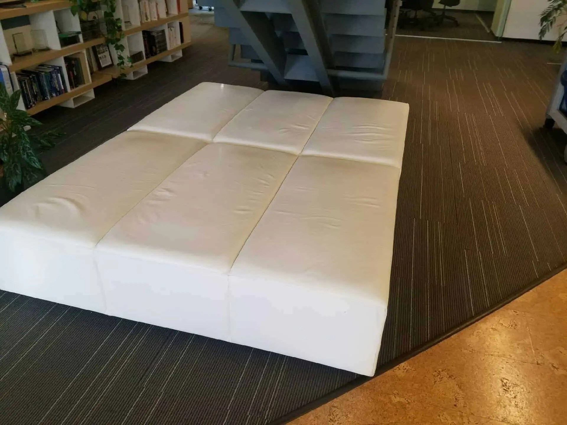pre owned white leather ottoman used