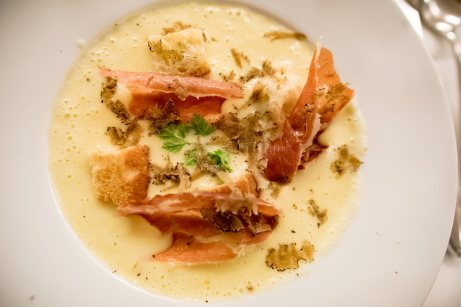 French restaurant in Munich – Potato, cheese, truffle, ham soup